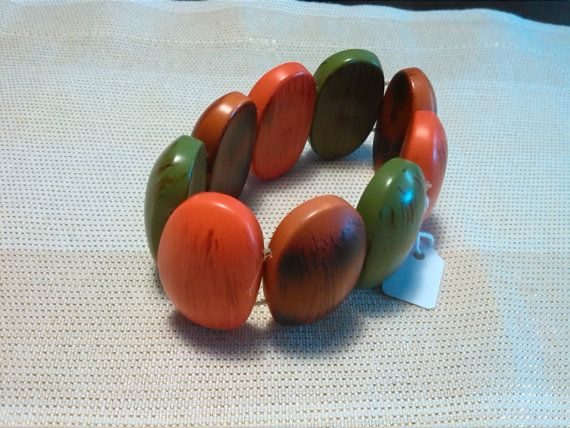 Very nice and colourful wooden bracelet by ColourOfTheBreeze