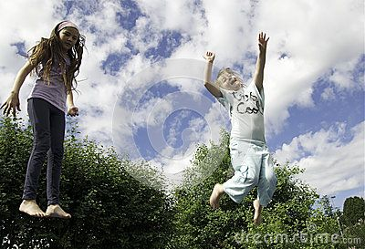 A young girls  jumping on a trampoline.