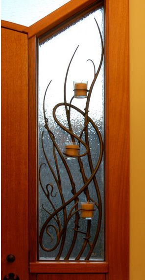 Custom Window Grill with candle holders built in.  By Daniel Hopper
