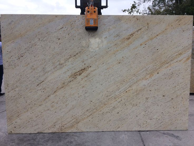 #IvoryGold granite is low variation #naturalstone with shades of beige, gold, white and yellow. A perfect #granitecountertops slab for light or dark #kitchencabinet or #kitchenisland.