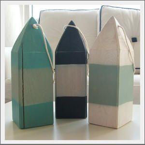 Seaside Inspired   decorative wood buoys from seasideinspired.com