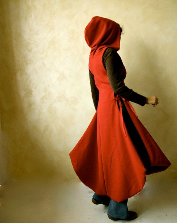 Red hooded Cape, Medieval cape, Winter dress, Winter coat, medieval cloak, hooded cloak, LARP. This is the winter version of the medieval tunic! Made in wool and fully lined, it is open on both sides to be worn over a wide long skirt or pants, closing regulable through 3x3 metal eyelets per side and leather or fabrics strings (as you prefer). It has a rounded hem and a big hood.