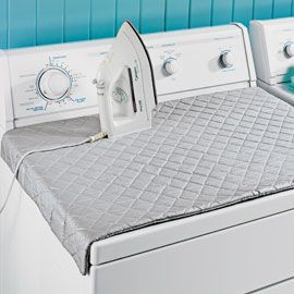 Quilted ironing board with magnets--how clever! instead of a bulky ironing board. Easy to store