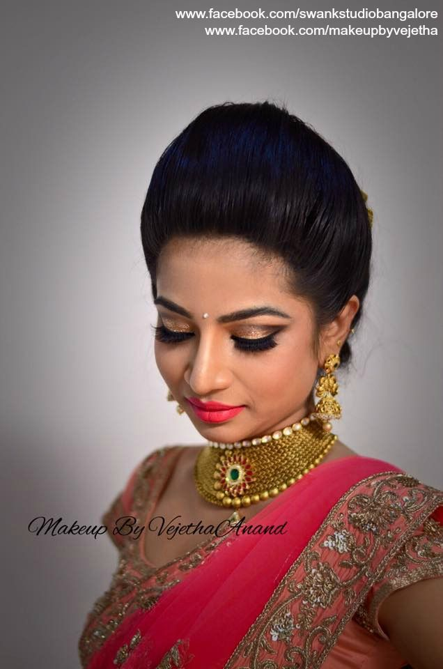 Indian bride Dr. Sukanya wears bridal lehenga and jewelry for her Reception. Makeup and hairstyle by Vejetha for Swank Studio.  Indian bridal makeup. Glitter eye makeup. Pink lips. Bridal jewellery. Bridal hair.  Find us https://www.facebook.com/SwankStudioBangalore