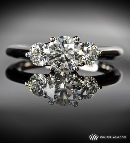 Google Image Result for http://wedding-pictures-05.onewed.com/5824/whiteflash-trois-brilliant-three-stone-diamond-engagement-ring__full.JPG