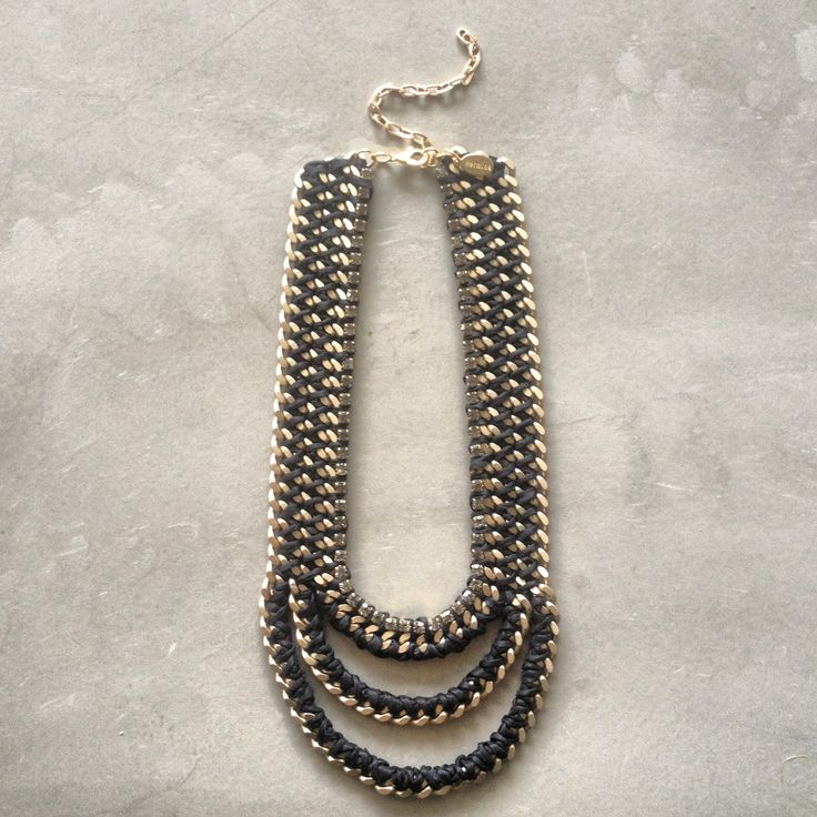 The Mouth necklace with Swarovski crystals in black and matte gold chain by Hermina wristwear and more