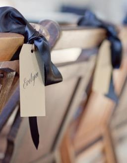 place card idea: doubles as a chair decoration...personalized wedding chair sign ribbon bow
