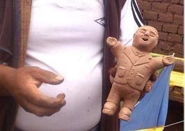 Bolivian Ekeko dolls is being made.