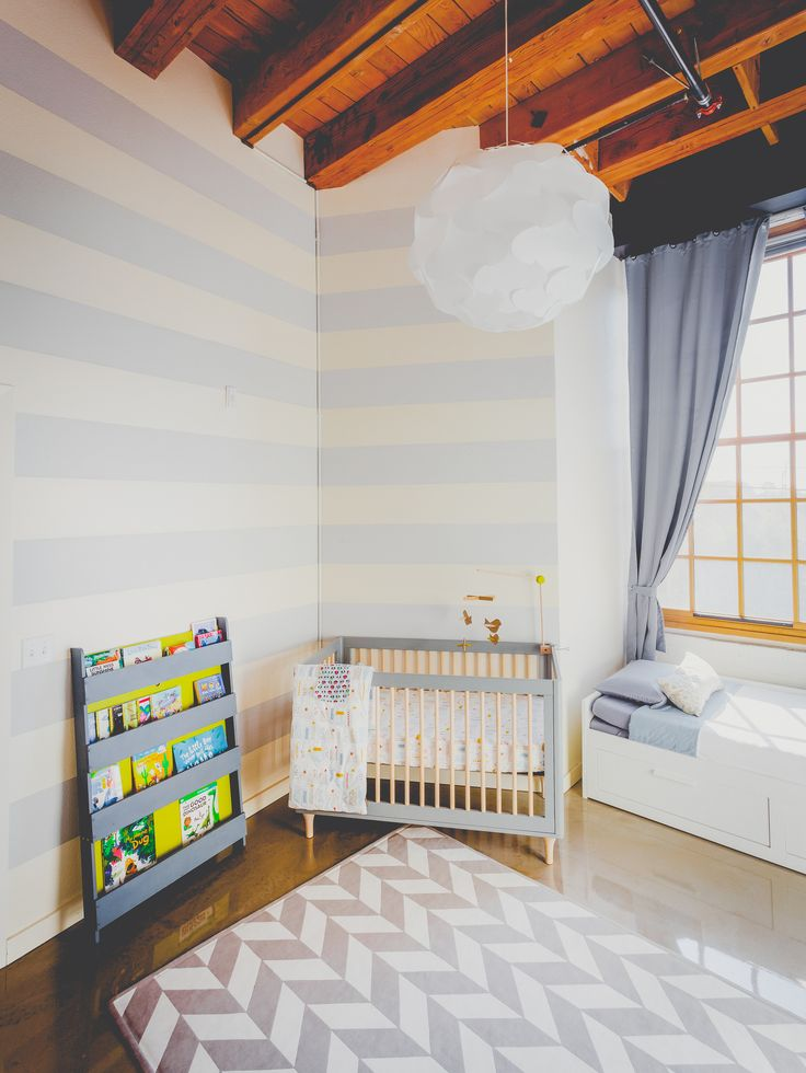 Modern nursery room, stripe wall