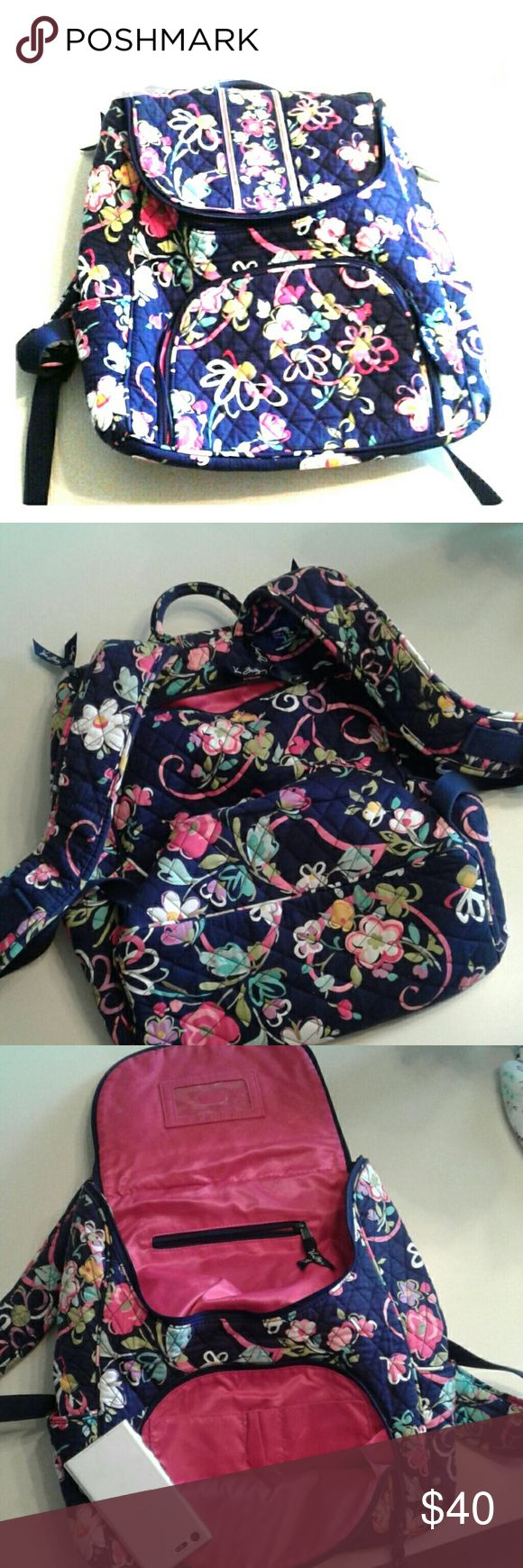 Vera Bradley Backpack Cute perfect condition Vera Bradley backpack with a pink shimmery inside. Tons of zippers and pockets on the side for storage. Vera Bradley Bags Backpacks