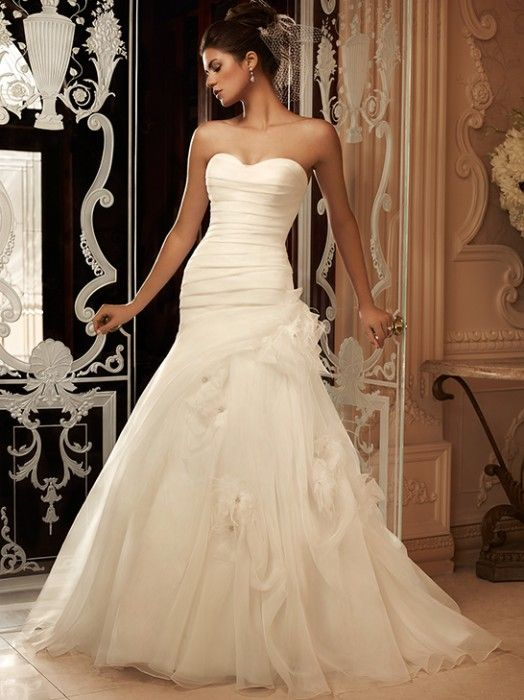 Flattering structured bodice with a fun tulle and flower skirt  {Casablanca Bridal wedding gown}  ~~Get your custom designed wedding gown at www.theonecouture.com