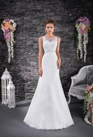 Viola is a full lace classic fit and flare wedding gown with tie up and button detail at the back.