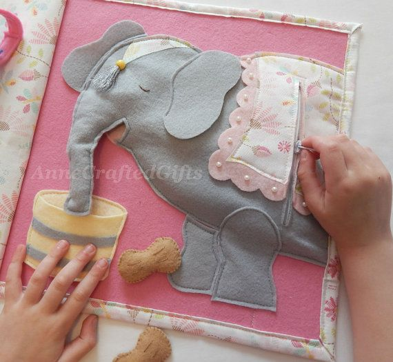 This fun, handmade toy for little girls is a great gift idea. Also creative ideas for your own felt quiet book page. Children feed the elephant and unzip the back to pull the peanuts out. #AnneCraftedGifts