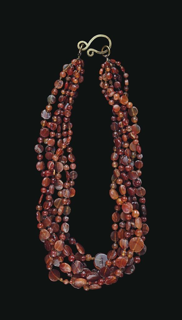 A WESTERN ASIATIC CARNELIAN BEAD NECKLACE CIRCA LATE 3RD-EARLY 2ND MILLENNIUM B.C.
