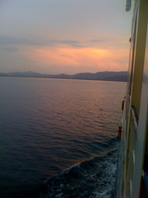 Sun setting as my ferry arrives into Lembar Harbour Lombok. Perfect timing.