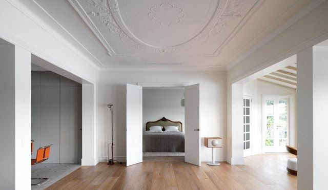 French Provincial inspired apartment in Point Piper, Sydney. The client's taste; clean and yet earthy, was what lead them to choose this sepia finish which ties the room nicely with the overhead timber beams, white walls, rustic chesterfield Ottoman and ornate ceiling plaster - www.tonguengrooveflooring.com.au