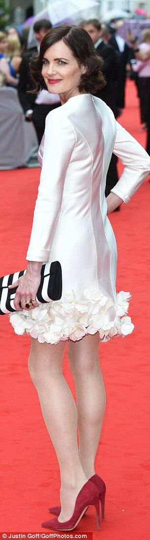 Not so mumsy now! Elizabeth McGovern showed off her fabulous legs in a satin mini dress...