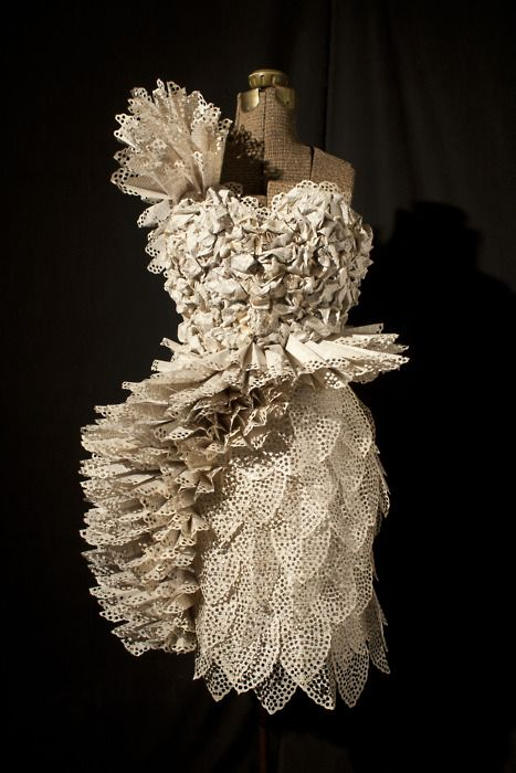 Artist Carrie Ann Schumacher creates these amazing dresses from the pages of books..... and a hole puncher!