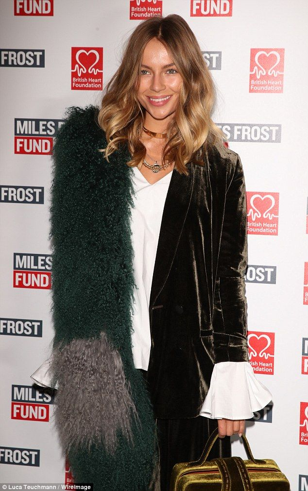 Quirky: Emma showed off her model stats in a velvet moss-green loose-fitting trouser suit