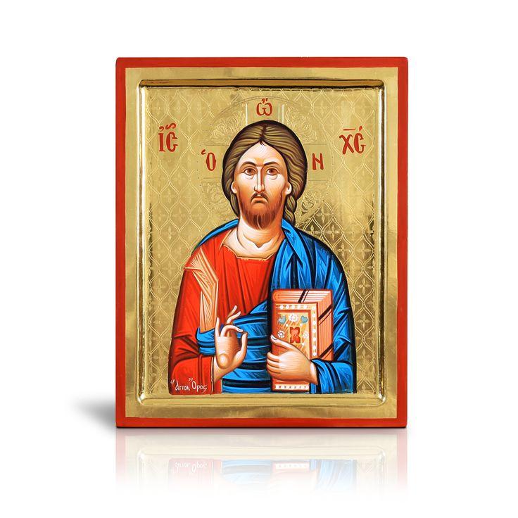 Στο πρόσωπο του Χριστού οι αγιογράφοι αποδίδουν με αυγό και χρώμα σε σκόνη την μύτη μακρόστενη συμβολίζοντας έτσι την πνευματική ευωδία της Αγίας Τριάδος. Η εικόνα αυτή εντυπωσιάζει με τις λεπτομέρειες της πτυχολογίας και με το τσουκανωτό ολόχρυσο φόντο της. - In the face of Christ, the iconographers depict the nose oblong symbolizing in this way the spiritual fragrance of the Holy Trinity. It is available with the approval and blessing of the Holy Skete of Mikra Agia Anna, Mt athos, Greece.