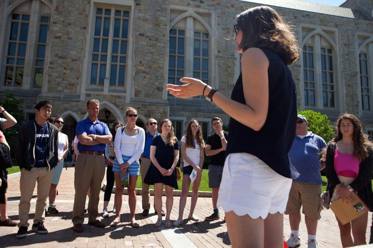 Eliza Voltz, a senior at Boston College, led a campus tour for prospective students and parents Wednesday.