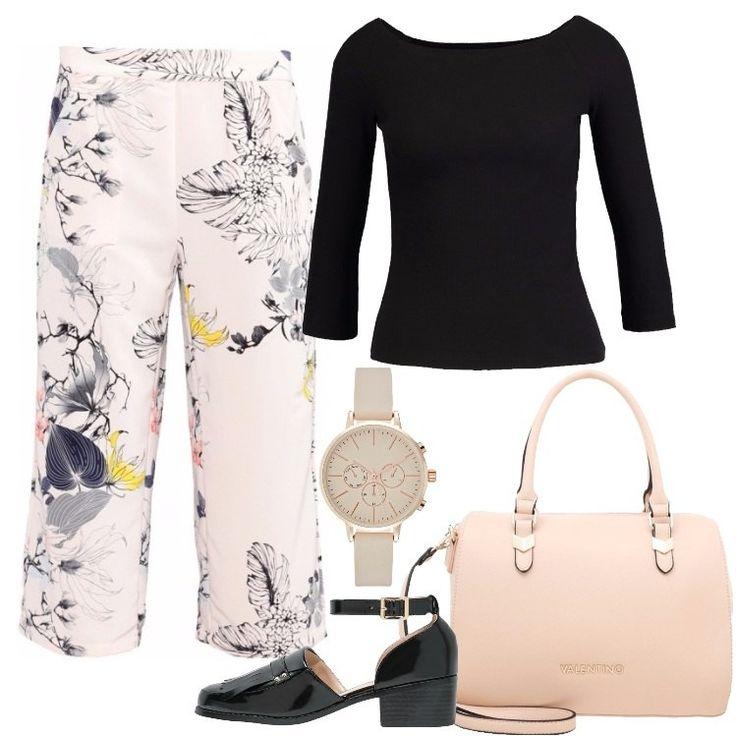 Un look composto da un pantalone davvero comodo, una maglia nera semplicissima ed un paio di tacchi neri in vernice, è perfetto per chi vuole stare comoda tutto il giorno, senza rinunciare allo stile.