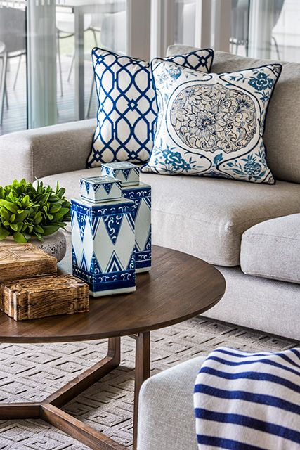 Blue and white accents in living room #gingerjars