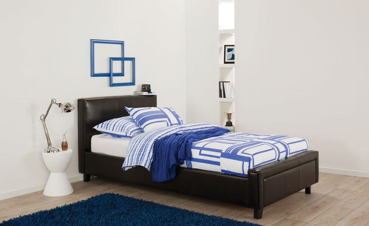 Lara modern minimal leather upholstered bed with blue and white patterned linen and décor