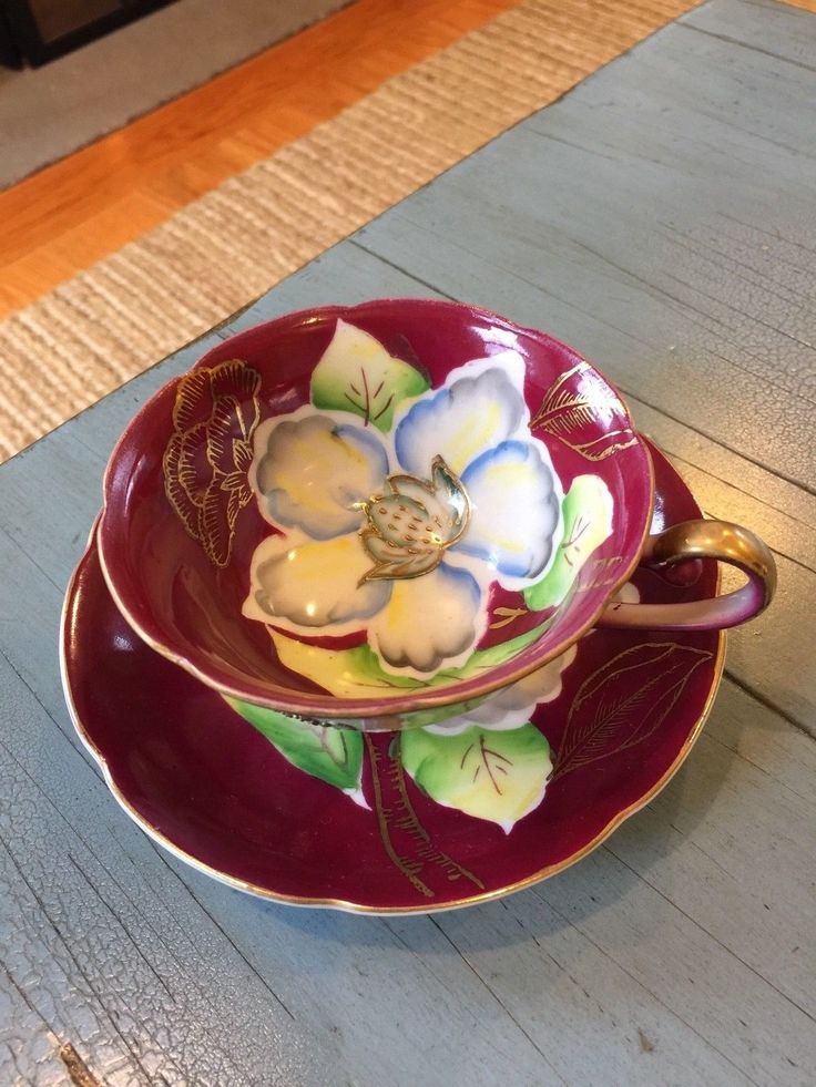 SAJI Tea Cup and Saucer Made In Occupied Japan Maroon Floral Footed - CAD $19.44. This listing is for a beautiful teacup and saucer made in Occupied Japan by Saji. The cup has pretty floral and gold designs. The footed cup measures 2 1/8 inches tall, and the saucer is 5 1/4 inches across. The set is in good, vintage condition with some wear to the paint in places. Please see my other teacup listings. Thank you! 232684703885