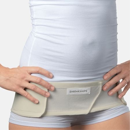 Bummed you can't work out for 6 weeks after baby? You can do something by wearing Shrinkx Hips Ultra Postpartum Hip Compression Belt. For the 8 weeks after delivery, while Relaxin levels are high, you can shrink your hips back to their original or smaller size. Must be worn within 8 weeks of delivery while Relaxin levels are still high.