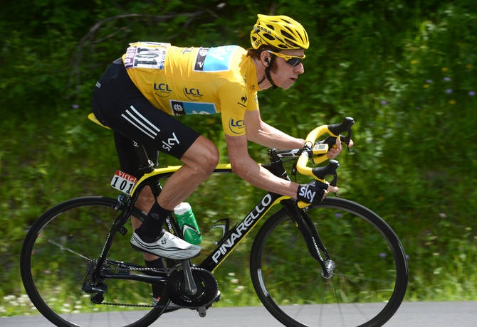 Bradley wiggins (sky) in full flight aboard his yellow-accented pinarello dogma 2 and wearing bonts ultralight zero shoes: bradley wiggins (sky) in full flight aboard his yellow-accented pinarello dogma 2 and wearing bonts ultralight zero shoes