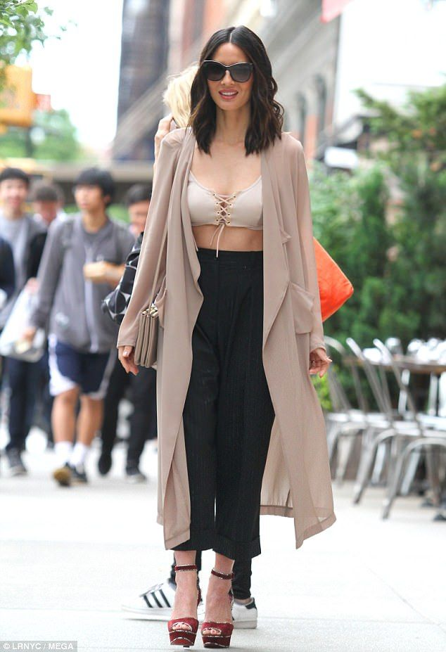 Wow factor: Olivia Munn put on quite the sexy display in a lace-up bralette while out and about in New York City on Wednesday