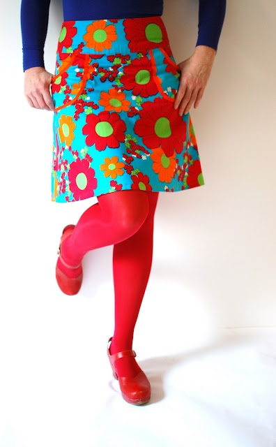 bright skirt, red tights, red shoes.