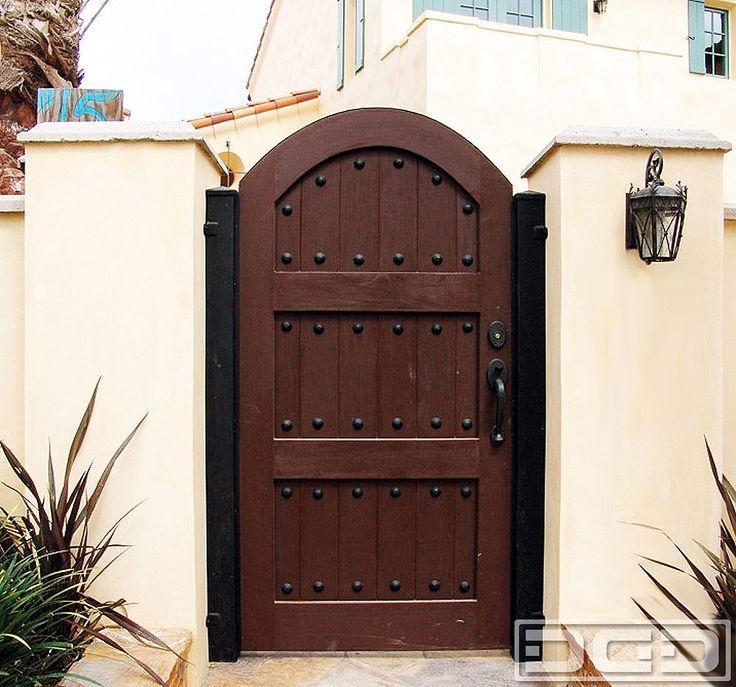 Spanish style wooden gates dynamic garage door for Door in spanish