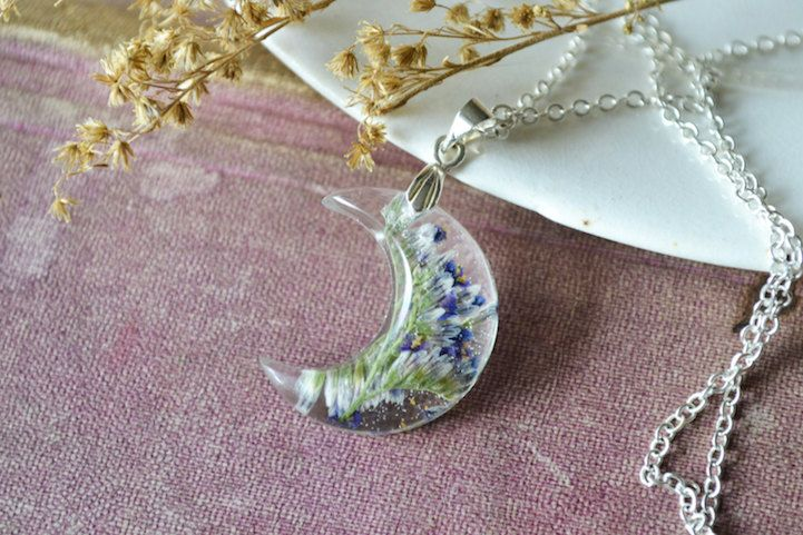 Artist Christina Hutchinson combines the cosmos and Earth in her series of exquisite resin necklaces. Through her shop called Luna Flora Designs, she sells inch-tall crescent moon pendants that are filled with real pressed flowers and strung on silver chains. The tiny blooms offer an intimate look at nature's beauty, as the artistic process has …