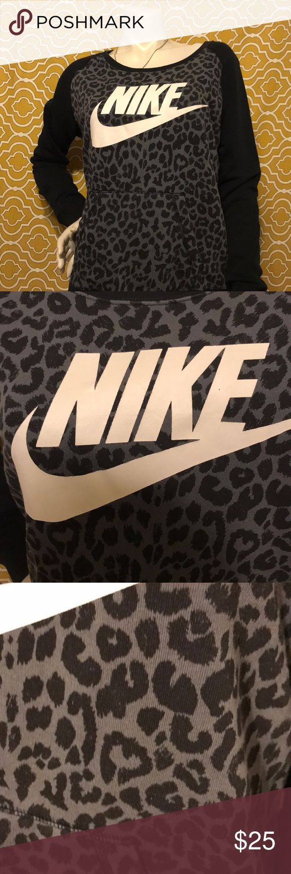 Nike leopard hoodie Black and grey leopard print Nike hoodie with logo and black arms in a size medium! In great preloved condition! Super warm and comfortable for those lazy cooler days. Open to offers 😊 Nike Sweaters