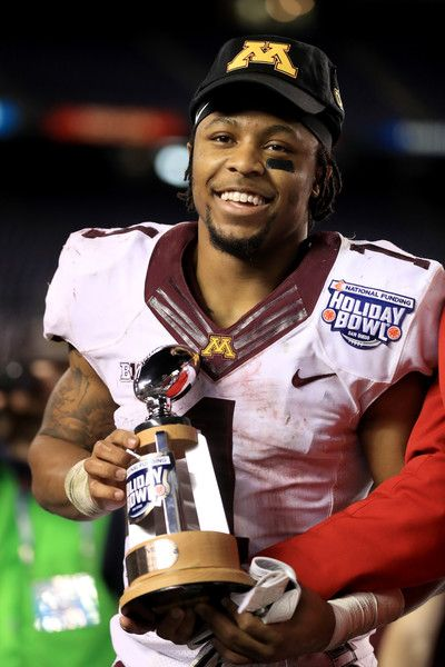 Rodney Smith #1 of the Minnesota Golden Gophers holds the offensive player of the game trophy after defeating the Washington State Cougars 17-12 in the Holiday Bowl at  at Qualcomm Stadium on December 27, 2016 in San Diego, California.