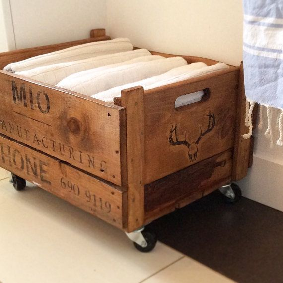 Recycled crate with casters for extra towels