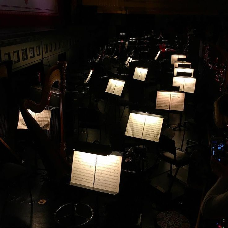 Inside the orchestra pit at the SF Opera House where I saw The Nutcracker.  Rows and rows of sheet music #orchestra #nutcracker #nutcrackerballet #musicpic #conductor #ballet #stage #show #behindthescenes #lit #intermission #sheetmusic #music #holidays #backstage by tinywren