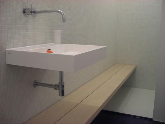 washbasin Clou, tap from Vola, glassmosaic and bench in grey oak