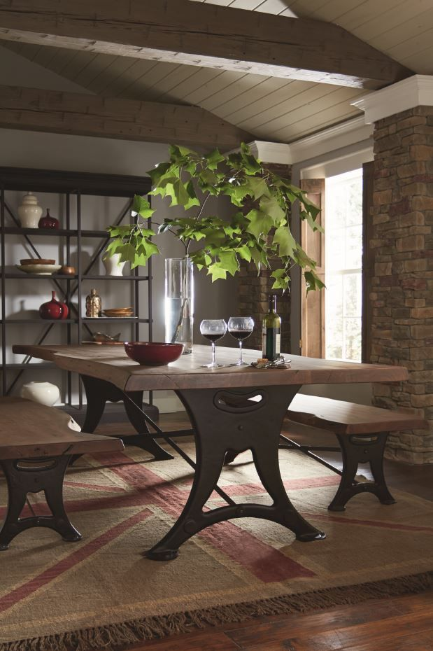 This live-edge dining table is hand built from planks of solid, inches thick Acacia, then hand-rubbed with a rich finish. Contours are complimented by antique zinc iron support.