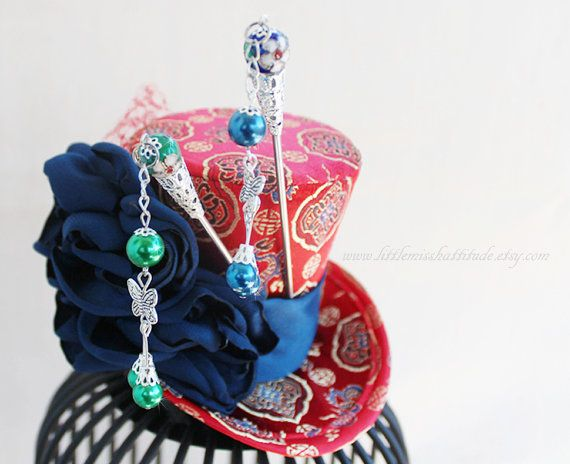 https://www.etsy.com/ca/listing/186530897/chinese-hat-chinese-hair-accessories?ref=shop_home_active_1 Chinese Hat Chinese Hair Accessories by LittleMissHattitude, $65.00