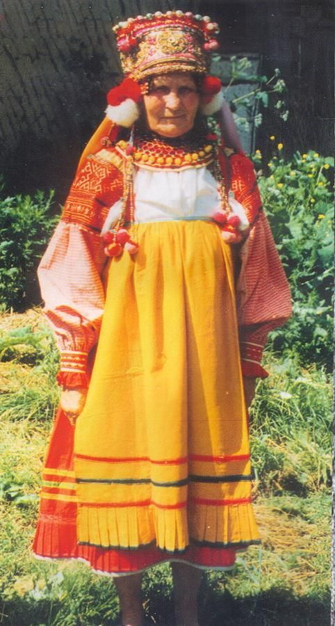 Traditional Russian costume from Orel region, Bolkhov district, Aleshna village (Russia)    Made by Polina V. Egorochkina (on the photo)    The photo was taken by ethnografic expedition of Derbenevka center, directed by A.V.Boukatov