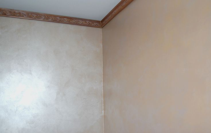 The faux on this wall was done using a pearlescent glaze giving this guest room a sophisticated look. You can get different looks with this same technique by changing the base wall color!