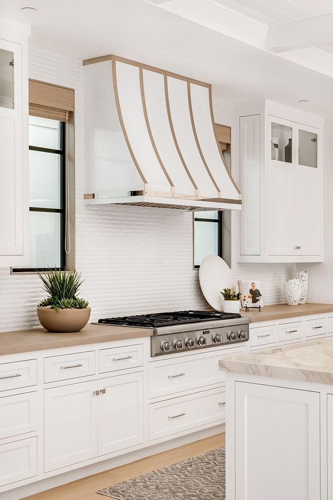 White Coated Range Hood With Metal Straps And Rivets A Custom White Coated Range Hood With Metal Stra Home Interior Design House Interior White Shaker Cabinets