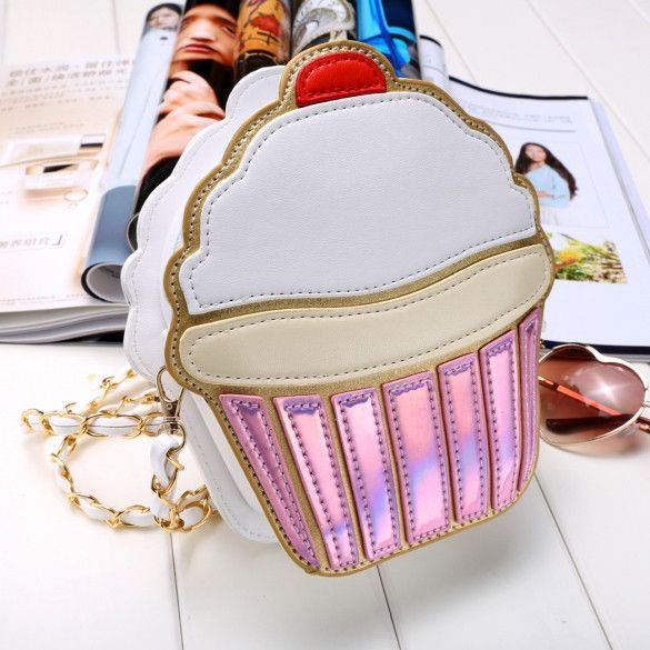 Caught you caking...cupcakin' that is! Store your phone, MAC lipstick, keys and other items in this cute, cupcake emblem purse!