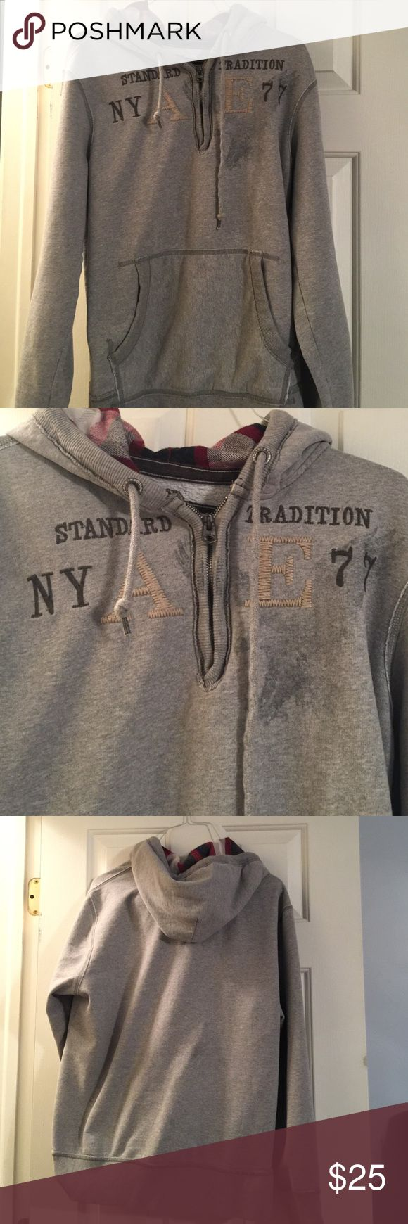 American Eagle Size Large Hoodie Grey Pull Over American Eagle Hoodie. SIZE Large. Front pocket, and partial zip in front. Flannel material inside of hood. Only Worn a couple times. American Eagle Outfitters Tops Sweatshirts & Hoodies