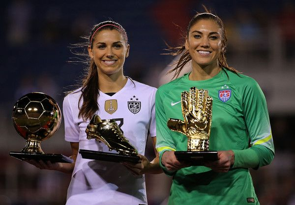 Hope Solo Alex Morgan Photos Photos - Alex Morgan #13 of the United States celebrates with the Golden Boot Award and MVP trophy and  Hope Solo #1 of the United States poses with the Golden Glove award after winning a match against Germany in the 2016 SheBelieves Cup at FAU Stadium on March 9, 2016 in Boca Raton, Florida. - 2016 SheBelieves Cup - United States v Germany
