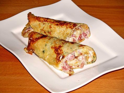 Pikante Pfannkuchen mit Schinken und Käse, ein beliebtes Rezept aus der Kategorie Snacks und kleine Gerichte. Bewertungen: 27. Durchschnitt: Ø 4,6.