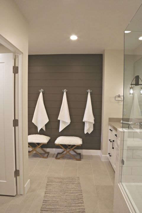 Painted shiplap accent wall bathroom.